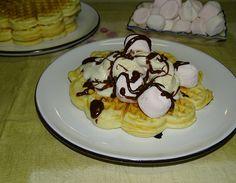 Waffles with vanilla ice cream, marshmallows and chocolate sauce