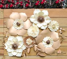 Set of 7 paper flowers and leaves in your choice of colors.  Beautiful and elegant paper flower backdrop. Perfect for weddings, events, showers, birthdays and home decor. Paper flower backdrop includes 7 different paper flower styles and leaves. Sizes of flowers: 2 - 18 2 - 14 3 - 6 assortment of leaves  All flowers are handcrafted using high quality cardstock.  (Send your color choice upon checkout.)  I love custom orders! Please feel to free to share any inspiration pictures and lets…