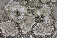 Diamante and Sequin Flower Motif in Silver/White