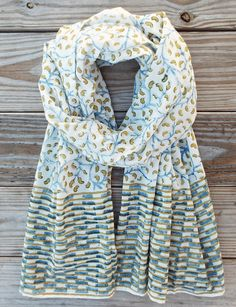 A light- weight and ethically made cotton scarf with a blue and yellow vine block print. Inspired by the ironwork found throughout New Orleans. Your purchase helps provide a secure job with fair wages and a positive working environment to artisans in Andhra Pradesh.