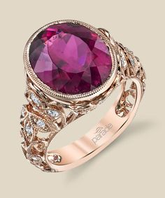 Milgrain etched scrolls of 18K glowing rose gold curl and climb toward a 7.41 carat magenta rubellite tourmaline. Diamond info: 22-RD 0.47, 01-RT 7.41 Fits center stone size OV: 13x11 Center stone not included.