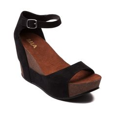 Shop for Womens Mia Jam Wedge, Black, at Journeys Shoes. Get down with this comfy low wedge delight! The Mia Jam Wedge features a soft two piece man made upper overlasted onto a subtle and stylish cork-textured wedge. Open toe design with an adjustable ankle strap closure and plush comfort footbed. 3.5 wedge heel, 1.25 platform.