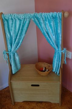 puppet theatre-this is cool because they could store their puppets in the bottom...