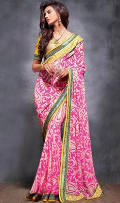 Cream and pink embroidered georgette sari is perfect for evening party as sari is garnished with all over block print motifs, woven lace and silk thread embroidered border which gives you an alluring look. Sari comes with contrast gold color and yellow raw silk stitched blouse as shown in the picture. #PrintedDesignCasualSaree