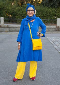 """Hely, 69  """"I've always had a bold and distinct style and I've always loved bright colours.  I like to shop second hand. My favourite fas..."""