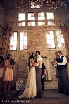 The kiss! Made more perfect by the brides Claire Pettibone, Queen Annes Lace dress.