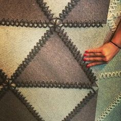 Graphic, stitched Baltic felt rug from Surya. High Point Spring Market 2014
