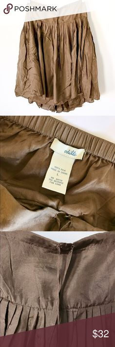 Anthro Odille Silk Pleat Skirt Beautiful silk skirt by Odille from Anthropologie.    Small pleats all the way around.   Fully lined in silk.    Drawstring at waist.    The color is a pretty, warm mocha or light brown.     Perfect condition with the exception of a stretch in the fabric (see fourth photo).   Classic Anthropologie. Anthropologie Skirts Midi