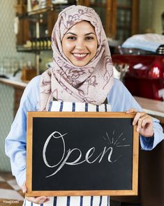 Islamic woman small business owner holding blackboard with smiling photo by Rawpixel on Envato Elements Muslim Family, Muslim Girls, Books To Read For Women, Golden Flower, Smile Photo, Business Photos, Blackboards, Plexus Products, Ladies Day
