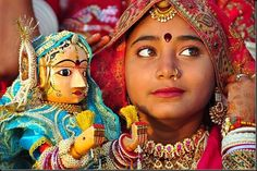 indian girl in all her finery at mewar festival