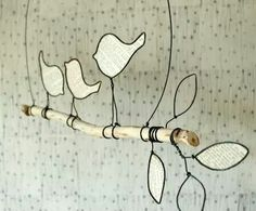 Wire birds, paper, branch