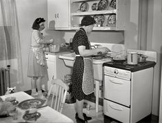 """Modern Kitchen,Spring """"New Bedford, Massachusetts. Family of Portuguese house painter who live in low-income government housing project."""" Medium format negative by John Collier for the Resettlement Administration Vintage Pictures, Old Pictures, Old Photos, Old Kitchen, Vintage Kitchen, 1940s Kitchen, Kitchen Stuff, Shorpy Historical Photos, 1940s Home"""