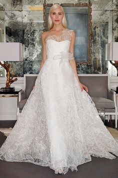 This Romona Keveza one shoulder lace wedding dress is so elegant and beautiful.