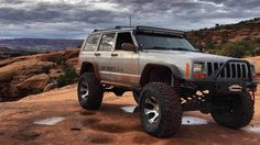 Watch this Jeep drive straight up this nearly vertical rock face!