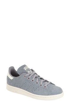 Putting a twist on the classic Adidas Stan Smith sneaker with textured grey leather.
