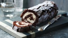 Mary Berry's gorgeous chocolate roulade is made without flour so it's light as a feather. Add berries to the whipped cream filling to make a decadent dinner party dessert.