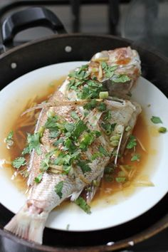Malaysian Style Steamed Fish, quickly steamed white fish flavoured with light soy sauce and brown suger topped with ginger, cilantro and chillies Malaysian Cuisine, Malaysian Food, Malaysian Recipes, Seafood Dishes, Seafood Recipes, Cooking Recipes, Asian Recipes, Healthy Recipes, Ethnic Recipes