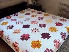 Wonderful example of Modern Crosses quilt in Modern Log Cabin Quilting -- @ JPL.