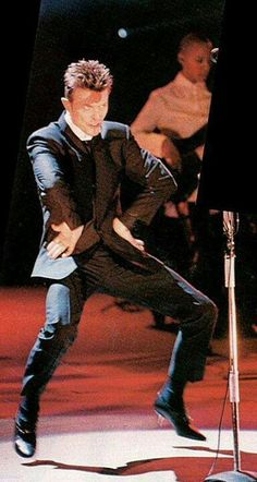 David Bowie performing at the Brit Awards January 1996.......received the Outstanding Contribution Award, presented by a gushing Tony Blair.....love those heel, Dave...
