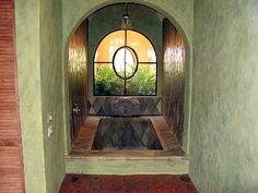 Dream Bath - I could expand our bathroom out and put in a sunken tub.  Love the window and the rainfall shower from the ceiling