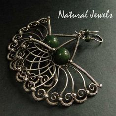 Bejewelled Jade - Earrings of 925 Sterling and fine silver wire and a bead of green Jade. €114.50, via Etsy.