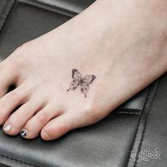 foot tattoo buterfly