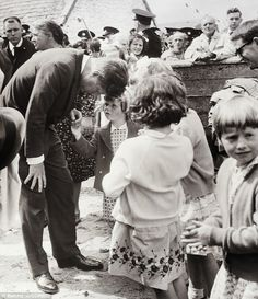 John F. Kennedy speaks to a young child while visiting his ancestral home Dunganstown, Ireland 50 years ago during a diplomatic tour of the country Us History, American History, Die Kennedys, Michael Collins, John Fitzgerald, Jackie Kennedy, Special People, Jfk, Lincoln