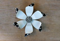 This big, bold and beautiful brooch is guaranteed to make a statement! A stunner in black and white, with a splash of polka dots this beauty