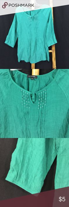 Notations Blouse. Regular Size Large 💋Notations Blouse. Regular Size Large. Made in Indonesia. 65% rayon. 35% polyester. 27 1/2 inches. Three-quarter sleeves. Embellished rhinestone front as shown. Notations Tops Blouses