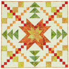 This bright quilt, perfect as a table topper or wall hanging, features a blazing star of fiery red, yellows, and orange batiks.