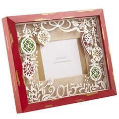 Turn a holiday photo into a lasting keepsake. Inside a frame of rustic red pine, a laser-cut ornament collage is layered to create a unique, 3-D shadow box effect. Dated 2015, it's the perfect frame for special holiday moments—ugly sweaters and all. Makes a great gift, too.