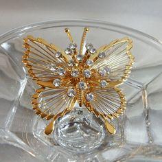 Vintage Monet Butterfly Brooch. Gold Tone Wire. Clear Rhinestones by waalaa on Etsy https://www.etsy.com/listing/177130488/vintage-monet-butterfly-brooch-gold-tone