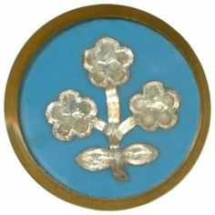 Glass inlay button with metal setting.