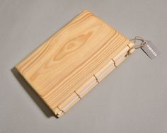 This is a hand-crafted pine wood sketchbook with round top finish, bounded with white string. The wooden covers are finished with semi-matte lacquer leaving its surface very smooth.  * 9mm cover * 144 extra-fine recycled paper sheets * made out of plain fir tree * light weight * binded tight and well * great for writing and drawing  Dimensions - A5( 21 x 15 cm / 8 x 6 in)