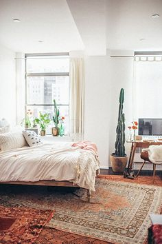Bedroom and workspace of Tessa Barton - shop the style: Mid Century Desk - Mid Century Chair - Net Tassel Duvet Cover - Venice Net Tassel Bolster Pillow - Bohemian Platform Bed - Eye Pillow - Body Pillow - Carved Wood Dresser - Pyramid Mirror Follow...