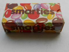 SMARTIES BOX.  These were mini boxes that came in a pack. I remember these from birthday parties!