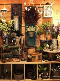 Garden display @ our shop - old shutters, metal containers, olive buckets, hanging lanterns, birdhouses, potted herbs & flowers, glass cloches, nests, wreaths, & more.   Shop inspiration, store ideas spring & summer, spring & summer decorating  Timeworn Treasures | Danville, PA                                                                                                                                                      More