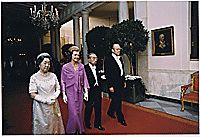Photograph of President Gerald Ford, First Lady Betty Ford, Emperor Hirohito and Empress Nagako Walking Down the Cross Hall Towards the East Room in the White House Prior to a State Dinner Held in Honor of the Japanese Heads of State , 10/02/1975