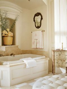 Cream walls, elegant tub surround, moulding...