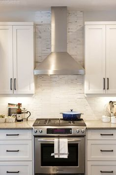 Jamie, this is how I envision the S/S oven and hood, with cabinets on the either side upper and lower with drawers. A Rustic & Modern White Kitchen by Calgary Interior Designer Most Popular Kitchen Design Ideas on 2018 & How to Remodeling White Kitchen Backsplash, Rustic Kitchen Cabinets, Kitchen Hoods, Kitchen Cabinet Design, Kitchen Redo, Interior Design Kitchen, Backsplash Ideas, Kitchen Ideas, Kitchen Modern