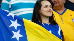 A Bosnia-Herzegovin fan shows her colours ahead of the 2014 FIFA World Cup Group F match between Nigeria and Bosnia-Herzegovina at Arena Pantanal on June 21, 2014 in Cuiaba, Brazil. (Photo by Matthew Lewis/Getty Images)  2014 FIFA World Cup Brazil™: Nigeria-Bosnia and Herzegovina - Photos - FIFA.com