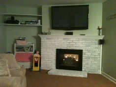 I whitewashed our fireplace after I became tired of the old, dark, red brick.  It had soot stains and was falling apart.  I glued it in place and whitewashed it in one night.  I gave the mantle a fresh coat of white, and a $100 black door from Lowes it was done. Whole project cost me $110 for the cement glue and new door. We already had the white paint!  :)