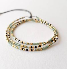 A delicate wrap bracelet made with hundreds of tiny, tiny (1.6 mm!!!) high quality Japanese seed beads in green and gold in an elegant color pattern. Try it on as an amazing, classy necklace as well. Featherweight and adjustable, it wraps around small to medium wrists 3 times (from around 15 cm/5.9 Tiny Tiny, Minimalist Necklace, Bracelet Sizes, Bracelet Making, Green And Gold, Gifts For Mom, Seed Beads, Glass Beads, Delicate