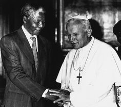 In this June 15, 1990 file photo, Pope John Paul II, right, shakes hands with Nelson Mandela, deputy leader of African National Congress, during a private audience at the Vatican.