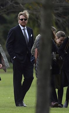 King Willem-Alexander of the Netherlands, along with friends and relatives, leaves the Memorial park in Pilar, Buenos Aires outskirts, after the burial ceremony of his father-in-law, Jorge Zorreguieta on on August 10, 2017.