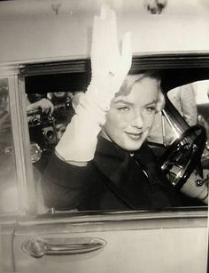 Marilyn Monroe after leaving the court house divorcing Joe Dimagio with a forced smile on her face for her fans