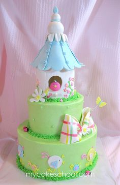 A birdhouse cake from a MyCakeSchool.com video~ Buttercream tiers with gum paste & fondant accents ;0)