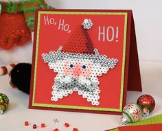 This cute Santa Star Card with its happy holiday message features a detachable ornament for the recipient to hang on their tree! Perfect for kids to make for friends or family.