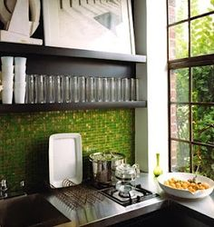 Iridescent recycled-glass mosaic tile from Oceanside Glasstile makes a glamorous (and green) backsplash.  Photo by Annie Schlechter  March 2007 p48