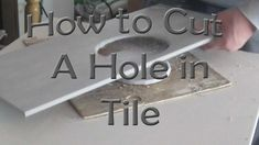 How to cut a hole in ceramic tile for toilet flange with an angle grinder - YouTube